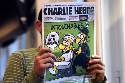 קריקטורה של מוחמד שפורסמה באחרונה בעיתון צרפתי (צילום: AFP )