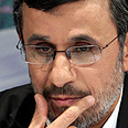 Ahmadinejad. Plays the game Photo: EPA