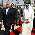 Haniyeh (L) and Al Thani in Gaza Photo: Reuters