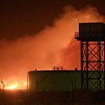 Factory in flames Photo: Reuters