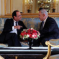 Netanyahu with Hollande in Paris Photo: Avi Ohayon, GPO