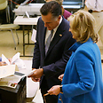 Mitt and Ann Romney vote Photo: AP