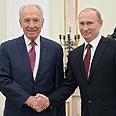 Peres and Putin Photo: EPA