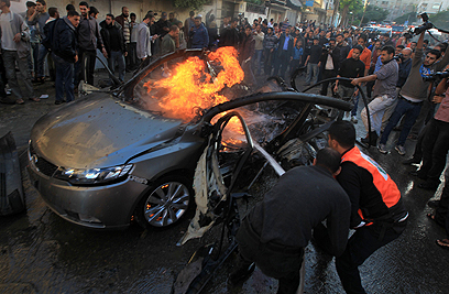 Jabari's car after IDF strike (Photo: AFP)