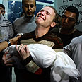 Gaza man holds his lifeless baby (archives) Photo: AP