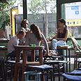 Empty Tel Aviv cafe, this week. Flight attendants stay away Photo: Moti Kimchi