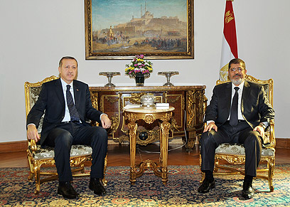 Turkish President Tayyip Erdogan and ousted Egyptian president Mohamed Mursi (Photo: AFP)