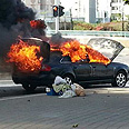 Damaged vehicle in Holon Photo: Gush Dan security services