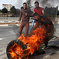 Burning tires in Hebron Photo: EPA
