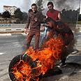Burning tires in Hebron Photo: EPA
