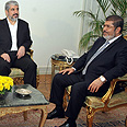 Mohammed Morsi and Khaled Mashaal Photo: Egyptian Presidency