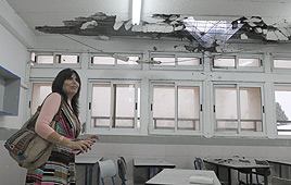 Homeroom #4 teacher assesses the damage Photo: Avi Roccah
