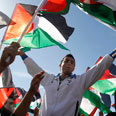 Palestinians celebrate UN vote Photo: AP