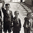 Jewish children forced to give Nazi salute