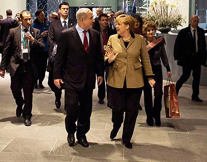 Netanyahu and Merkel (Photo: AFP)