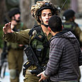 Confrontation in Hebron Photo: EPA