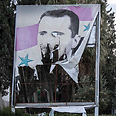 Syrian rebels pulling down Assad's poster Photo: AP