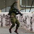 Soldier pelted with stones in Hebron Photo: AFP