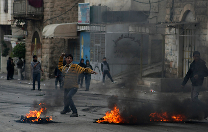 Riots in Hebron (Photo: AFP)