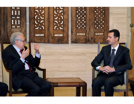 Bashar Assad with Brahimi (Photo: AP)