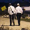 Settlers guarding outpost, Friday evening Photo: Ohad Zwigenberg