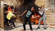 Palestinian youth throwing stones at Israeli security forces Photo: Reuters