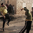 Palestinians hurl stones at security forces (archives) Photo: AFP