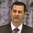 Assad holds on Photo: AFP