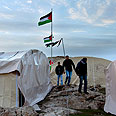 Palestinians at Bab al-Shams outpost, last week Photo: EPA