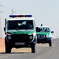 Algerian army jeeps patroling BP plant Photo: EPA