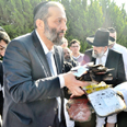 Aryeh Deri with the burnt books Photo: Nofi Dadush