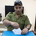 IDF soldier votes in Ashdod Photo: AFP