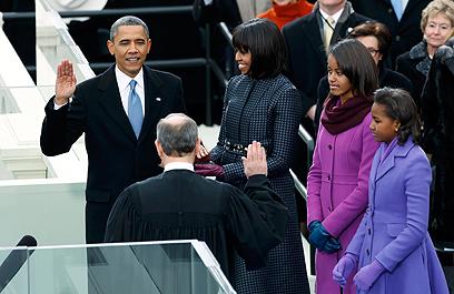 אובמה מושבע (צילום: רויטרס)