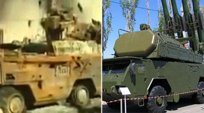הרכב שהופצץ (כנראה טילי SA-8) לצד מערכת טילי SA-17 ()