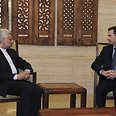 Assad and Iran's national security chief Photo: Reuters