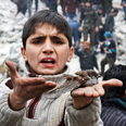 A child showing a bird wounded in the Aleppo bombing Photo: AP