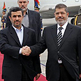 Ahmadinejad and Morsi Photo: EPA