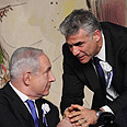 Netanyahu (L) and Lapid Photo: Gil Yohanan