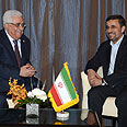 Abbas (L) with Ahmadinejad Photo: Gettyimages