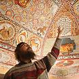Krakow-based Rabbi Boaz Pash looks at painted ceiling Photo: AP