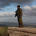 Israeli soldier watches Syria in Golan Heights Photo: EPA