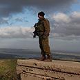 Israeli soldier overlooks Syria Photo: EPA