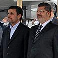 Ahmadinejad, Morsi Photo: AP