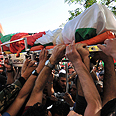 Abu Hamdiyeh's body carried by mourners Photo: AP