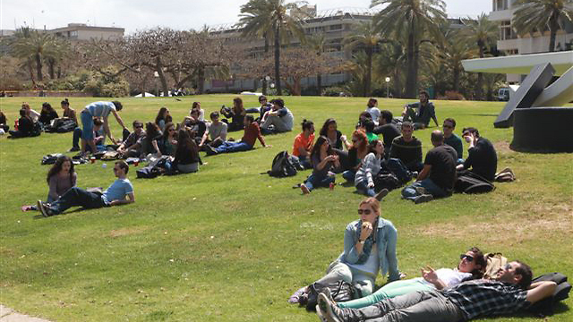Students lounging on the Tel Aviv University campus (Photo: Motti Kimchi)