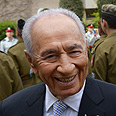 'Hand stained with blood.' Peres Photo: Amos Ben-Gershom
