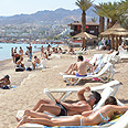 Tourist's average length of stay in Israel in 2012 was 8.2 days. Vacationing in Eilat (archives) Photo: Meir Ohayon