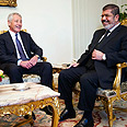 Morsi with Hagel Photo: Reuters