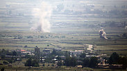 Syrian infighting on Golan as viewed from Israel Photo: AFP
