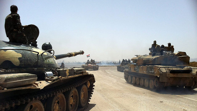 Syrian army tanks heading to Qusayr (Photo: AFP)